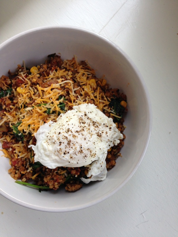 Black bean and corn quinoa with sauteed spinach and poached egg